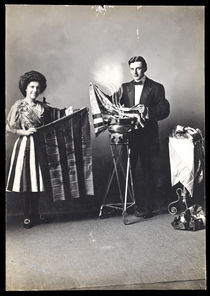 Magician and His Assistant Producing Flags