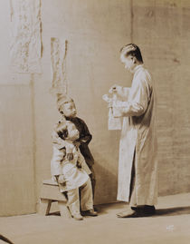 Portrait of Asian Magician and Two Children